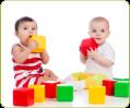 two babies holding blocks