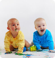 two babies cover with paint