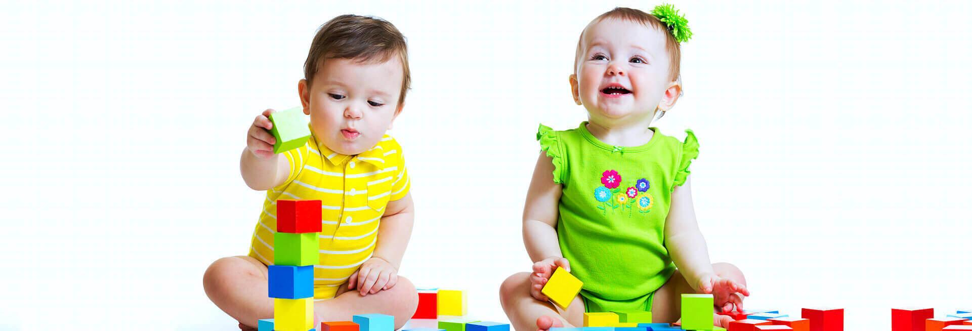babies playing blocks