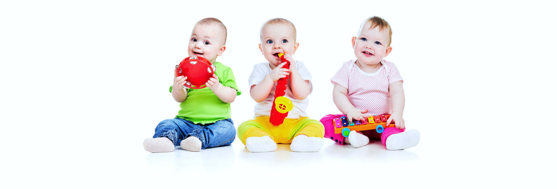 three babies smiling
